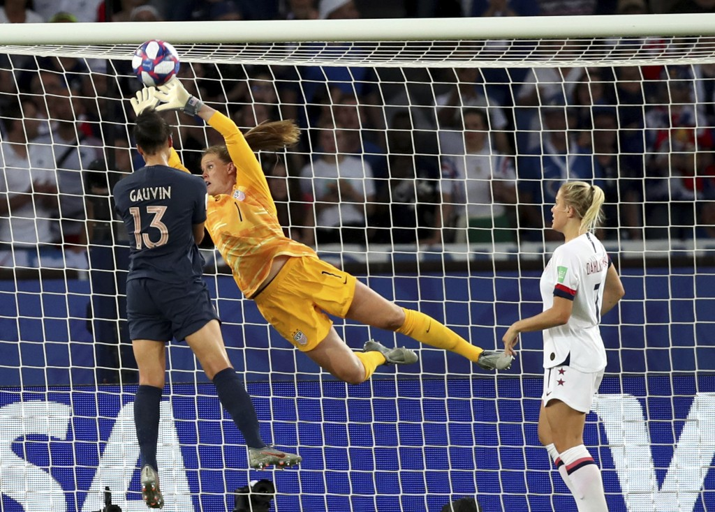 United States goalkeeper Alyssa Naeher (1) deflects the ball away from France's Valerie Gauvin during the Women's World Cup quarterfinal soccer match ...