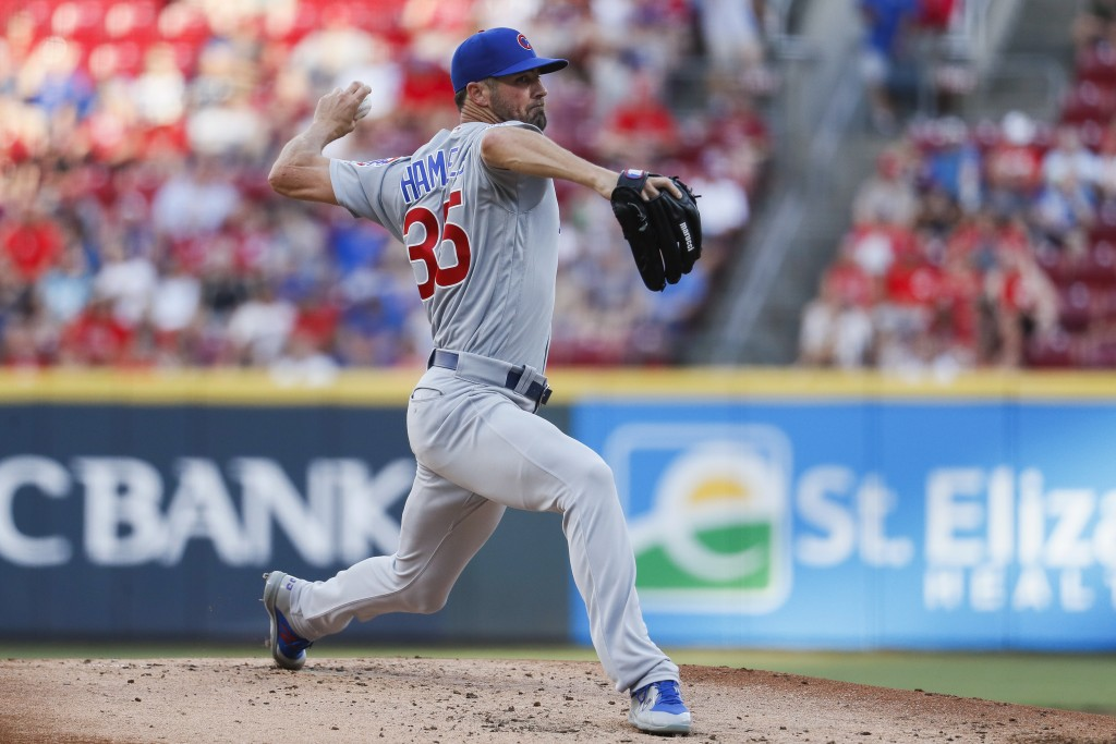 Chicago Cubs starting pitcher Cole Hamels throws during the first inning of the team's baseball game against the Cincinnati Reds, Friday, June 28, 201...