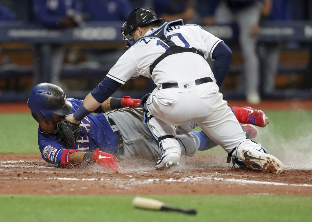 Tampa Bay Rays catcher Mike Zunino tags out Texas Rangers' Rougned Odor as he attempted to extend a triple into a home run during the sixth inning of ...