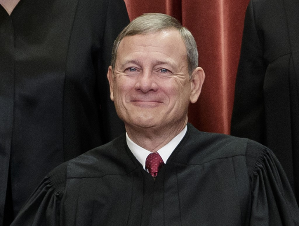 FILE - In this Nov. 30, 2018, file photo, Chief Justice of the United States, John Roberts, sits with fellow Supreme Court justices for a group portra...