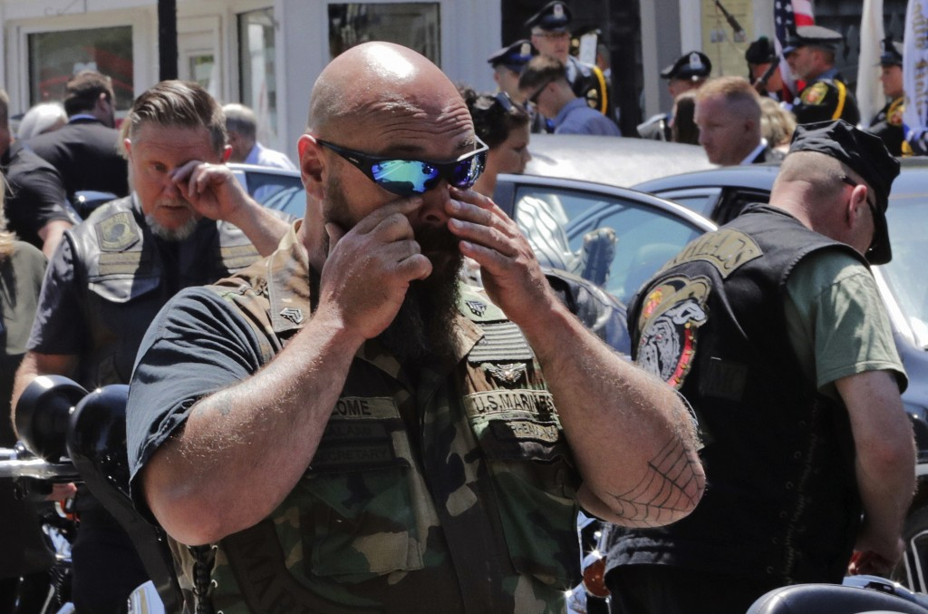 Members of the Jarheads Motorcycle Club react after the casket of Michael Ferazzi was loaded into a hearse following a funeral at St. Peter's Catholic...
