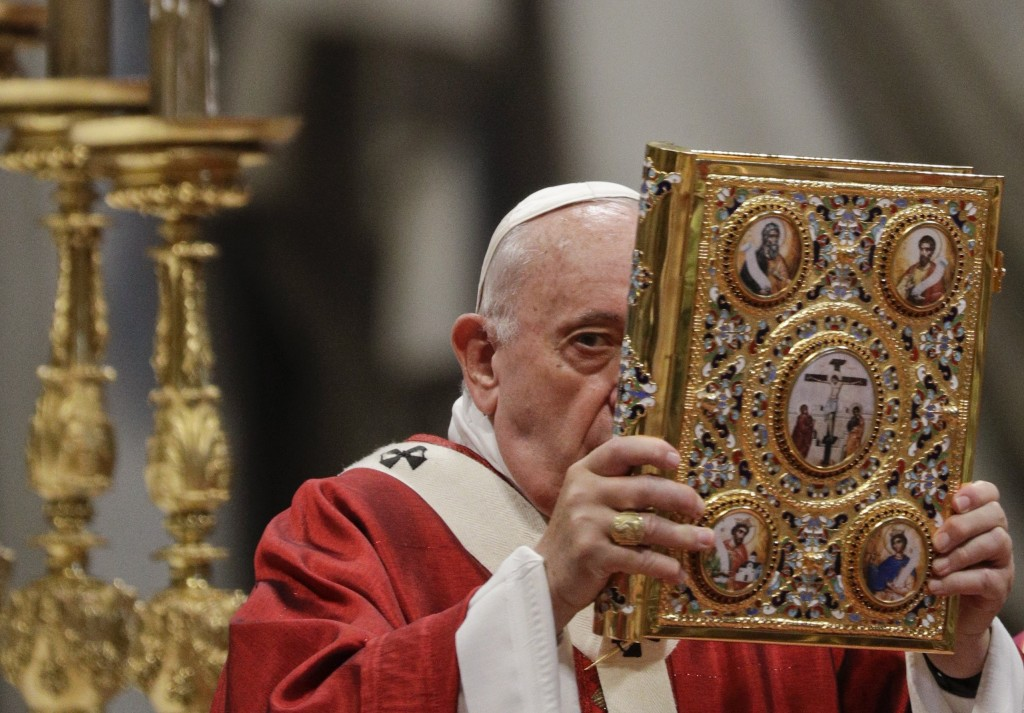 Pope Francis holds the book of Gospels as he celebrates Mass in St. Peter's Basilica at the Vatican, Saturday, June 29, 2019. (AP Photo/Gregorio Borgi...