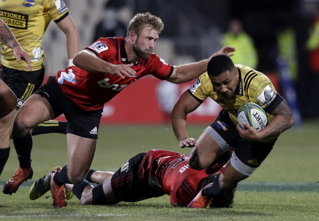Hurricanes Ngani Laumape is tackled by Crusaders Braydon Ennor, left, during the Super Rugby semifinal between the Crusaders and the Hurricanes in Chr...