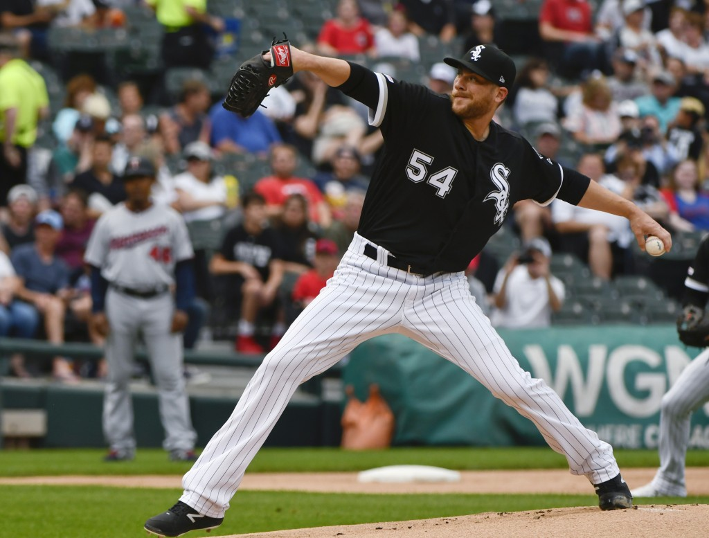 Chicago White Sox starting pitcher Ross Detwiler delivers during the first inning of the team's baseball game against the Minnesota Twins on Friday, J...