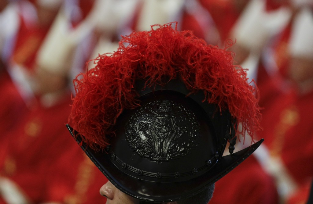 A Swiss Guard stands attention as Pope Francis celebrates Mass in St. Peter's Basilica at the Vatican, Saturday, June 29, 2019. (AP Photo/Gregorio Bor...