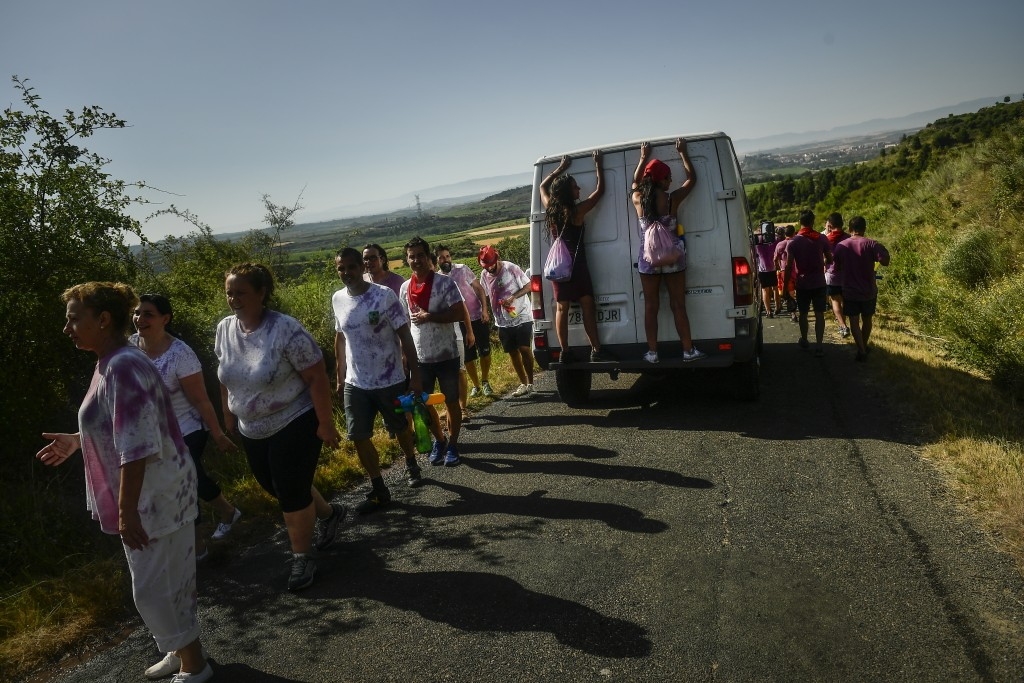 People leave the place at the end of wine battle, in the small village of Haro, northern Spain, Saturday, June 29, 2019. Hundreds of revelers particip...