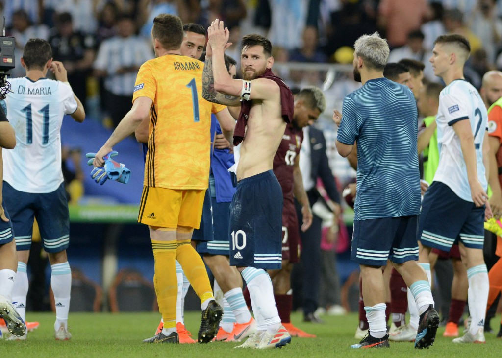Argentina's Lionel Messi acknowledges to fans at the end of a Copa America quarterfinal soccer match against Venezuela at the Maracana stadium in Rio ...