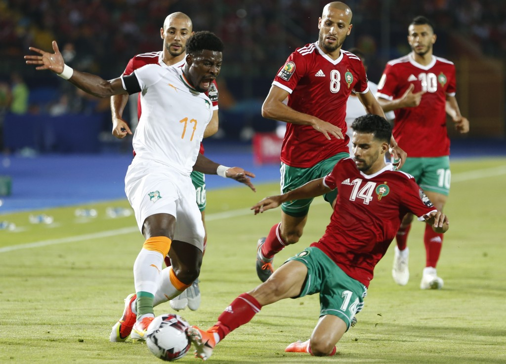 Morocco's M'brak Boussoufa clears the ball in front pf iv17\ during the African Cup of Nations group D soccer match between Morocco and Ivory Coast in...