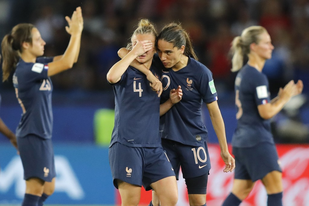France's Marion Torrent, center left, and Amel Majri react after the Women's World Cup quarterfinal soccer match between France and the United States ...