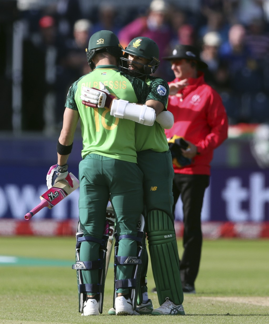 South Africa's batsman Hashim Amla, back embraces his captain Faf du Plessis at the end of the Cricket World Cup match between Sri Lanka and South Afr...