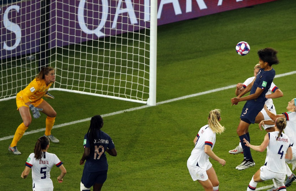 France's Wendie Renard, top right, scores her side's first goal during the Women's World Cup quarterfinal soccer match between France and the United S...