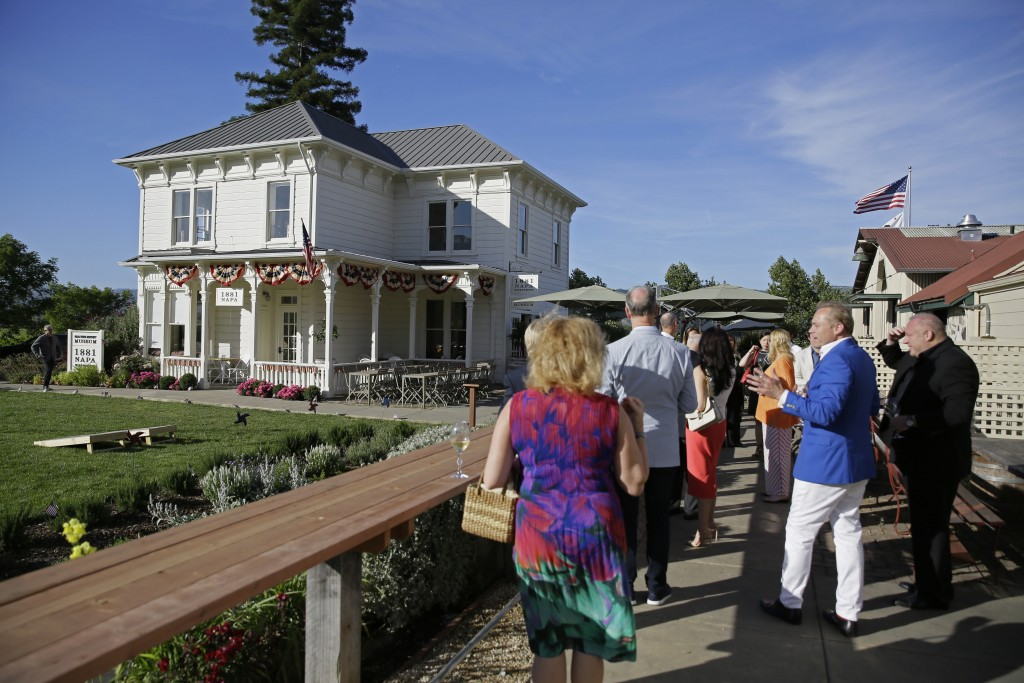 In this photo taken Wednesday, June 5, 2019, Jean-Charles Boisset, second from right, leads guests on a tour of the grounds outside 1881 Napa in Oakvi...