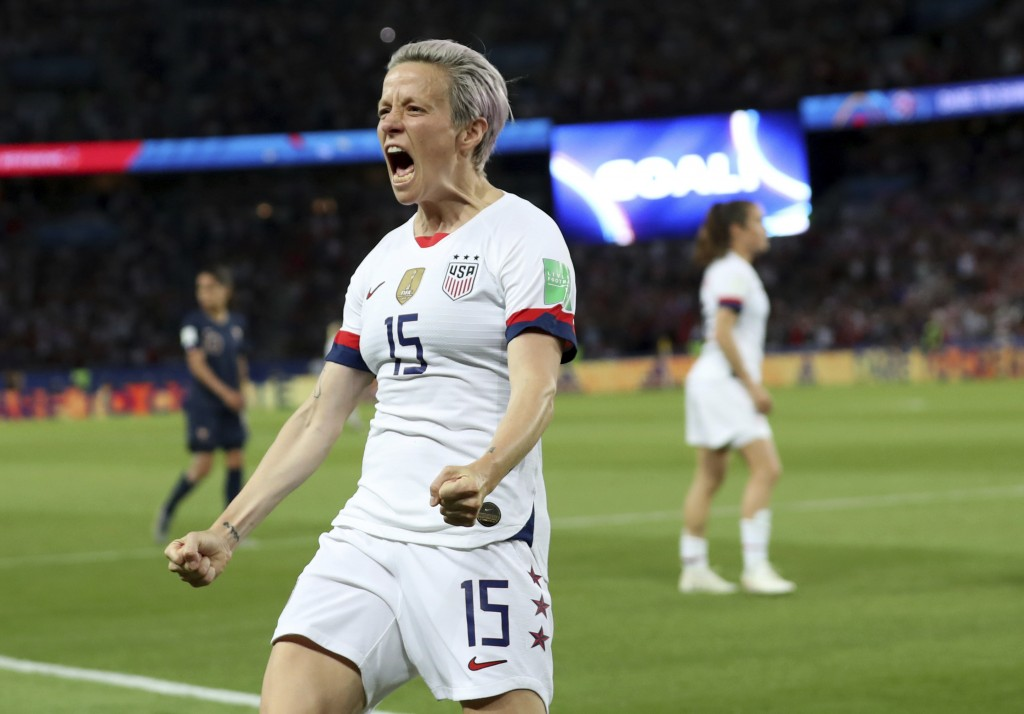 United States' Megan Rapinoe celebrates after scoring her side's second goal during the Women's World Cup quarterfinal soccer match between France and...