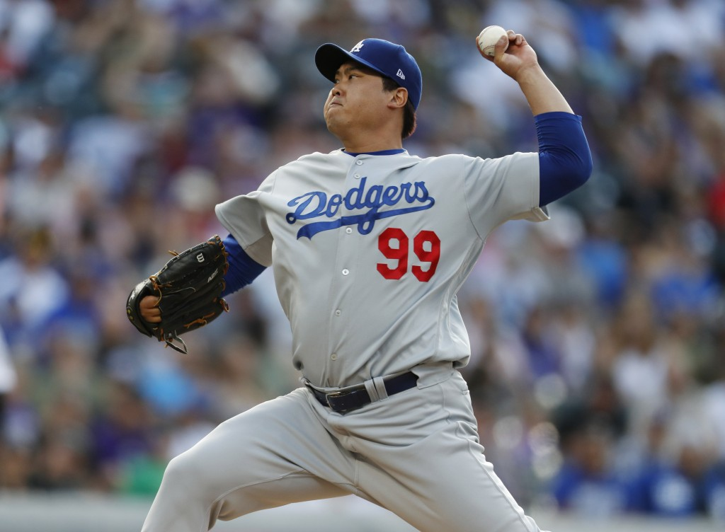 Los Angeles Dodgers starting pitcher Hyun-Jin Ryu works against the Colorado Rockies in the first inning of a baseball game Friday, June 28, 2019, in ...