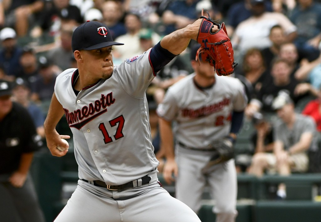 Minnesota Twins starting pitcher Jose Berrios delivers during the first inning of the team's baseball game against the Chicago White Sox on Friday, Ju...
