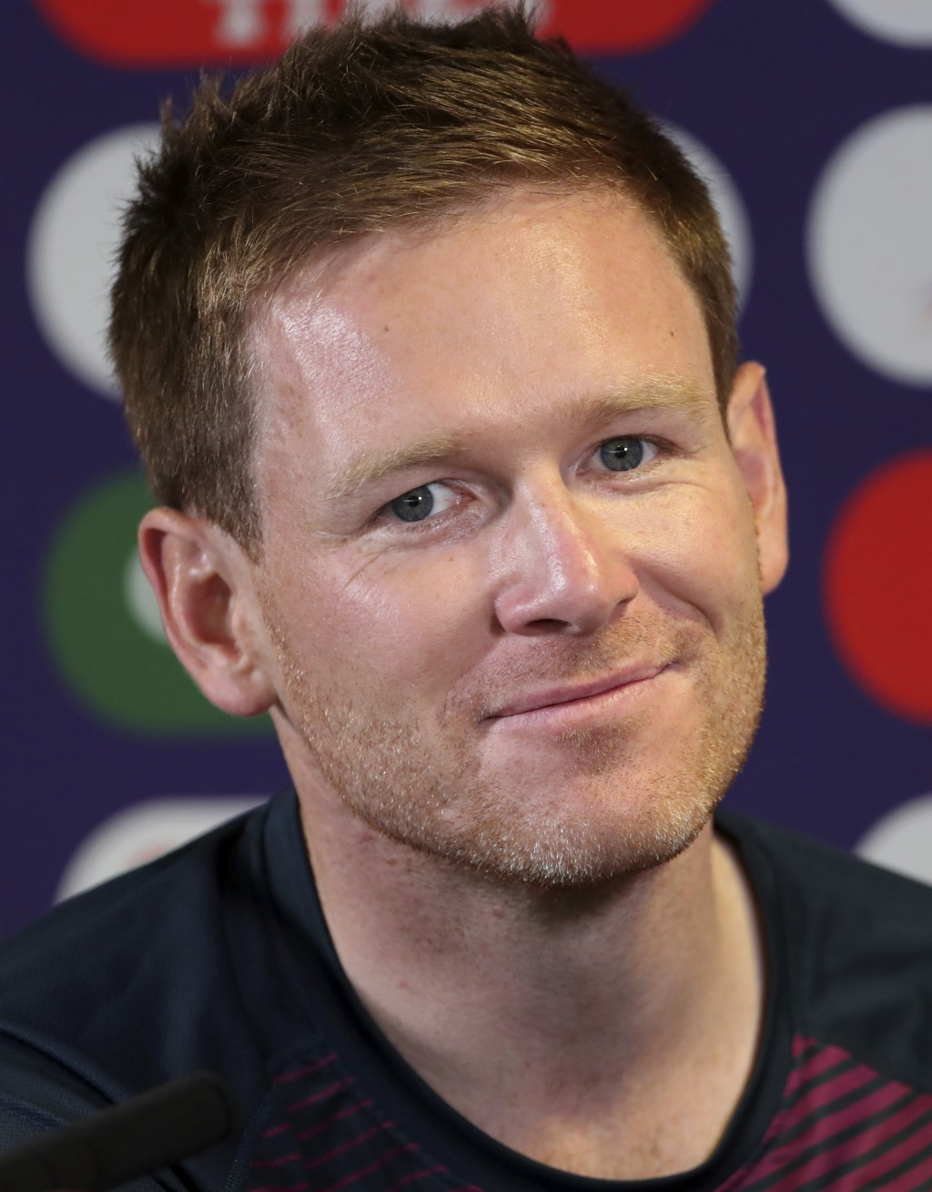 England's captain Eoin Morgan listens to a question from a journalist during a press conference ahead of their Cricket World Cup match against India a...