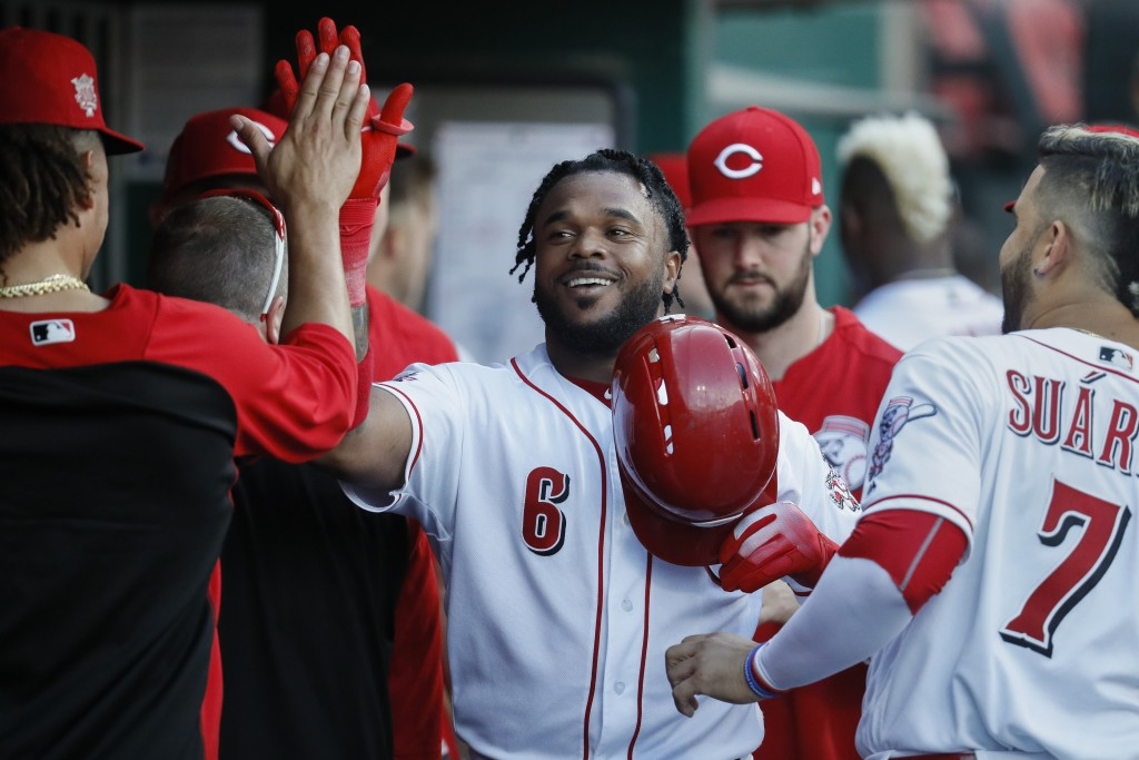 Cincinnati Reds' Phillip Ervin celebrates in the dugout after hitting a solo home run off Chicago Cubs relief pitcher Mike Montgomery during the secon...