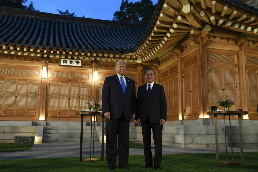 U.S. President Donald Trump, left, and South Korean President Moon Jae-in, right, pose for a photo during a visit to the tea house on the grounds of t...