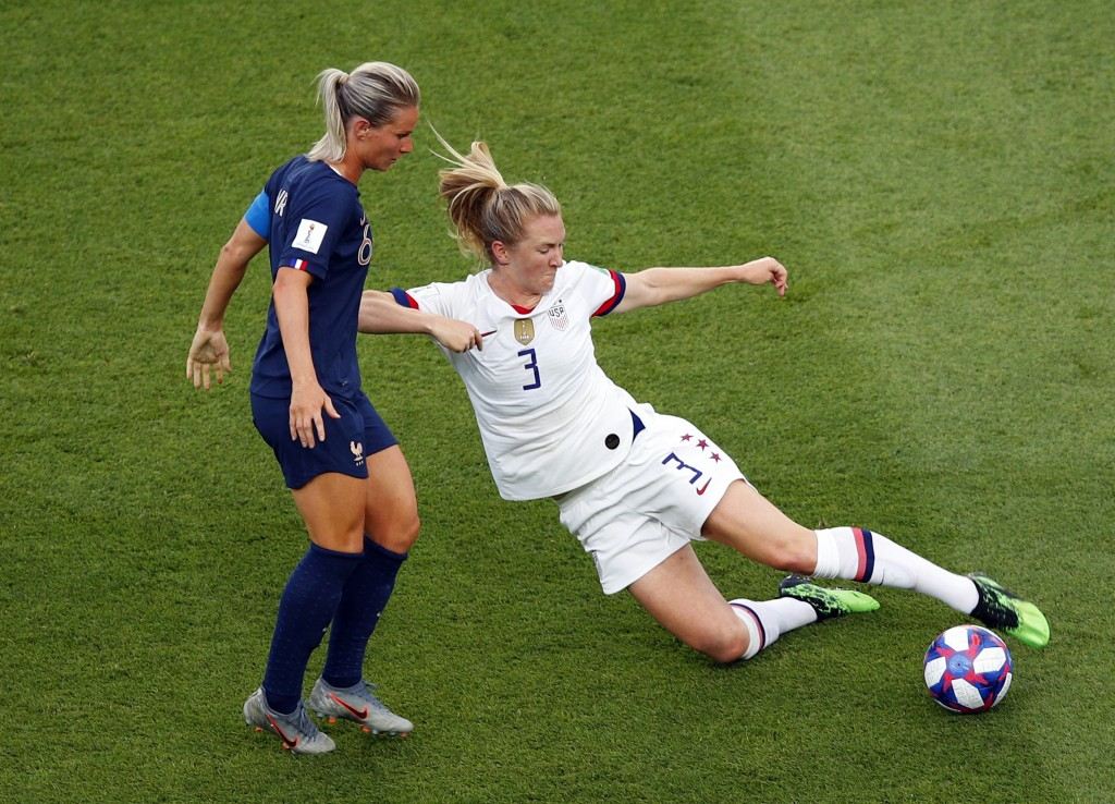 United States' Samantha Mewis, right, duels for the ball with France's Amandine Henry during the Women's World Cup quarterfinal soccer match between F...
