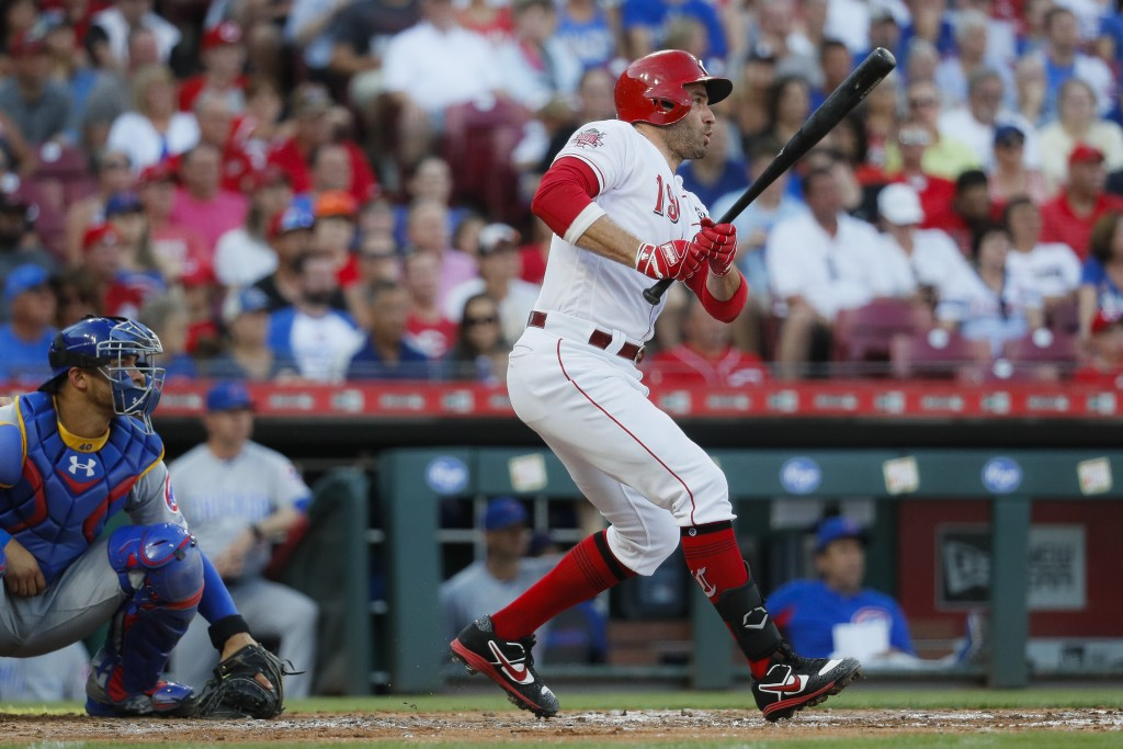 Cincinnati Reds' Joey Votto watches his single off Chicago Cubs relief pitcher Mike Montgomery during the second inning of a baseball game Friday, Jun...