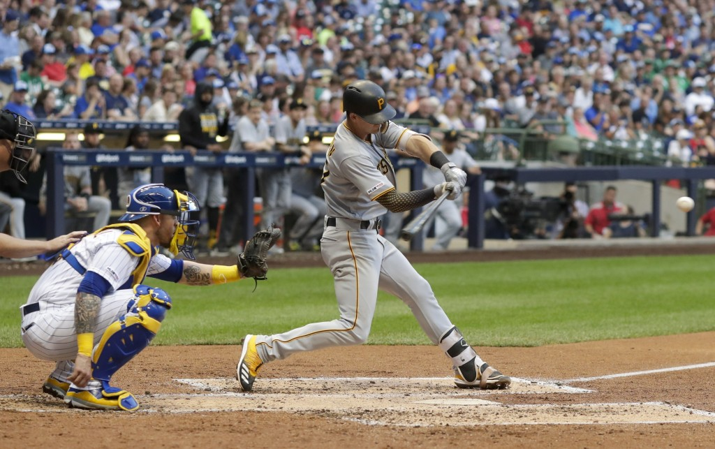 Pittsburgh Pirates' Kevin Newman hits a home run during the third inning of a baseball game against the Milwaukee Brewers Friday, June 28, 2019, in Mi...