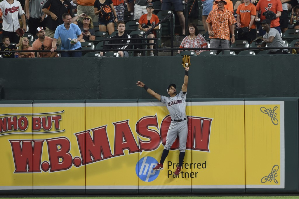 Cleveland Indians' Oscar Mercado leaps and catches a long fly ball hit by Baltimore Orioles' Chance Sisco in the fourth inning of a baseball game Frid...