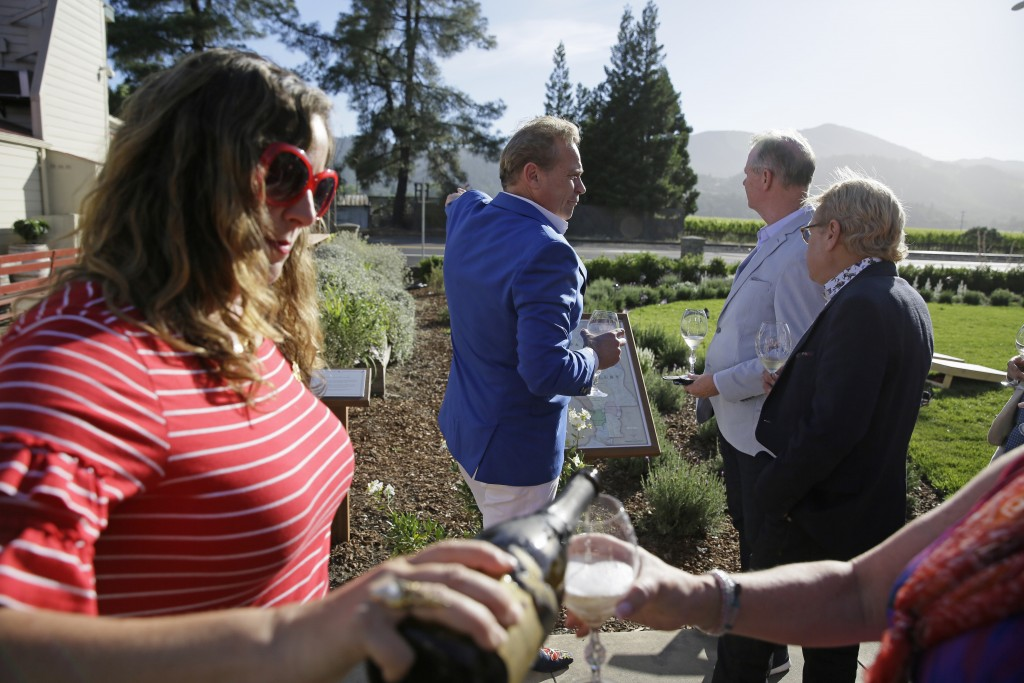 In this photo taken Wednesday, June 5, 2019, Jean-Charles Boisset, center, leads guests on a tour of the grounds at 1881 Napa in Oakville, Calif. 1881...