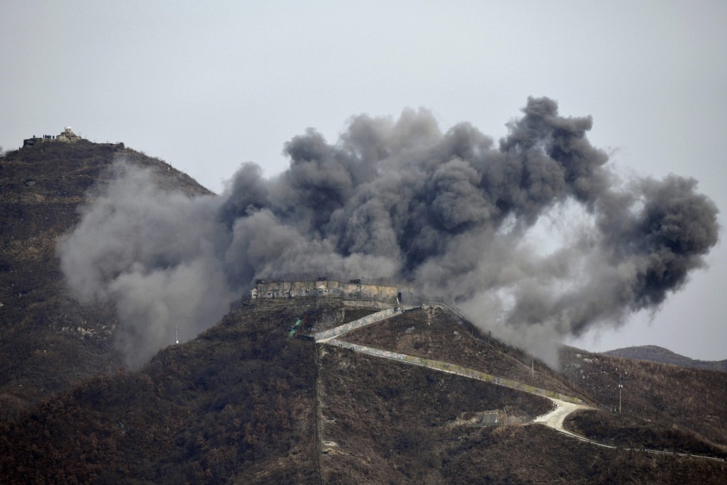 FILE - In this Nov. 15, 2018, file photo, smoke from an explosion rises as part of the dismantling of a South Korean guard post in the Demilitarized Z...