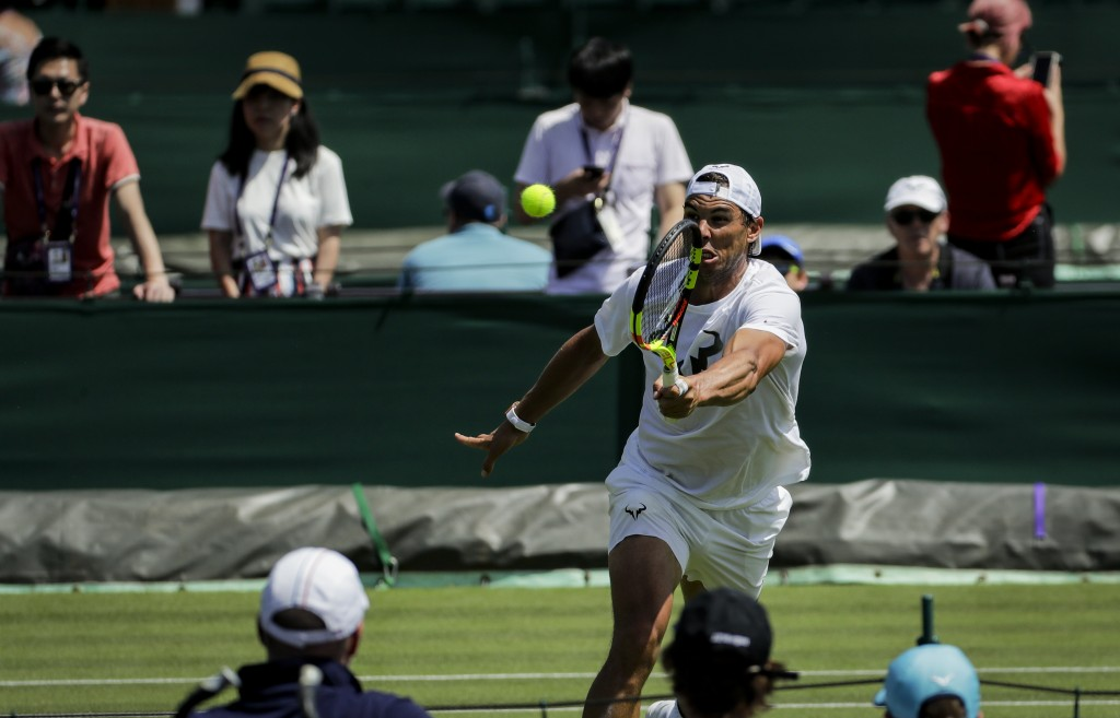 Spain's Rafael Nadal attends a practice session ahead of the Wimbledon Tennis Championships in London Saturday, June 29, 2019. The Wimbledon Tennis Ch...