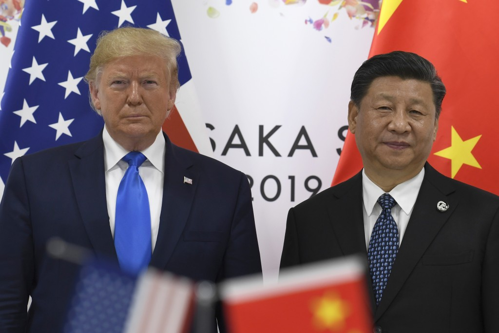 President Donald Trump, left, poses for a photo with Chinese President Xi Jinping during a meeting on the sidelines of the G-20 summit in Osaka, Japan...