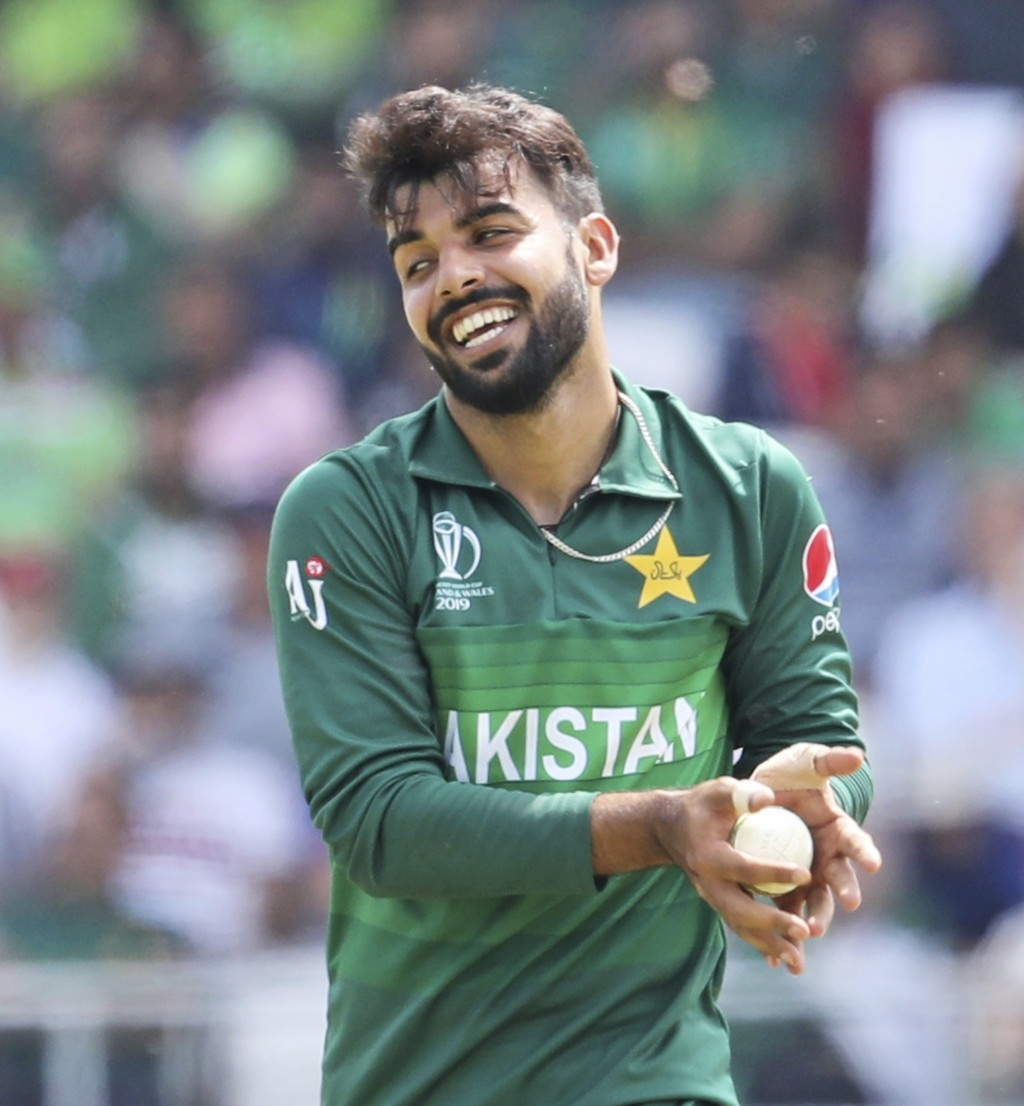 Pakistan's Shadab Khan prepares to bowl during the Cricket World Cup match between Pakistan and Afghanistan at Headingley in Leeds, England, Saturday,...