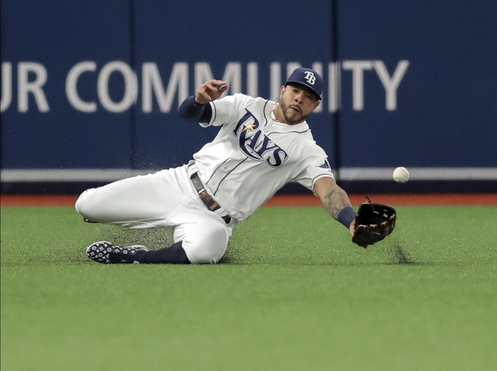 Tampa Bay Rays left fielder Tommy Pham misses a fly ball from Texas Rangers' Rougned Odor during the sixth inning of a baseball game Friday, June 28, ...