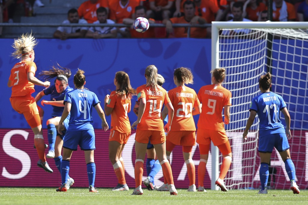 Netherlands' Stefanie Van Der Gragt, left, scores her side's second goal during the Women's World Cup quarterfinal soccer match between Italy and the ...