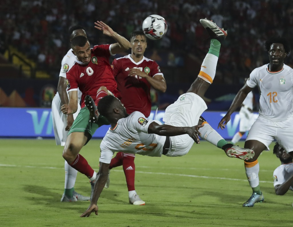 Ivory Coast's Ismael Traore shoots in front of Morocco's Games Saiss during the African Cup of Nations group D soccer match between Morocco and Ivory ...
