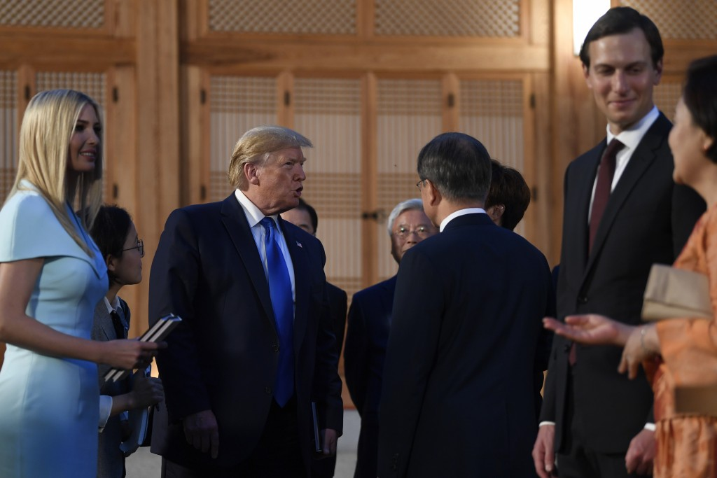 President Donald Trump, second from left, talks with South Korean President Moon Jae-in and other guests during a visit with South Korean President Mo...