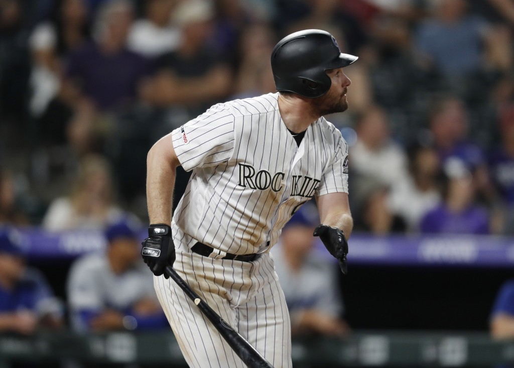 Colorado Rockies' Daniel Murphy watches his RBI sacrifice fly off Los Angeles Dodgers reliever JT Chargois during the eighth inning of a baseball game...