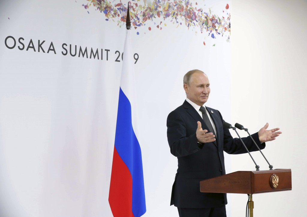 Russian President Vladimir Putin speaks to the media after the G-20 summit in Osaka, western Japan, Saturday, June 29, 2019. (Mikhail Klimentyev, Sput...