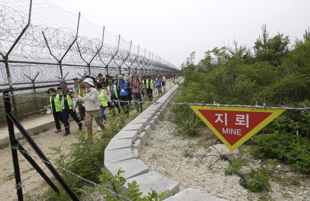 FILE - In this June 14, 2019, file photo, hikers and journalists walk along the DMZ Peace Trail in the demilitarized zone in Goseong, South Korea. Eye...