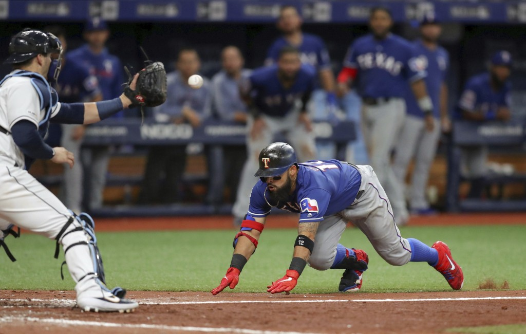 Tampa Bay Rays catcher Mike Zunino waits for the throw as Texas Rangers' Rougned Odor slides in to home during the sixth inning of a baseball game Fri...