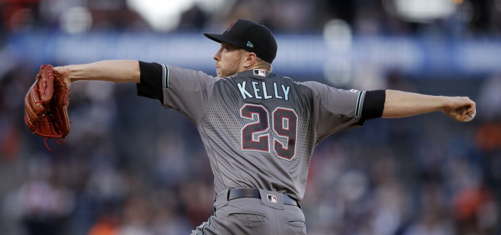 Arizona Diamondbacks pitcher Merrill Kelly works against the San Francisco Giants during the first inning of a baseball game Friday, June 28, 2019, in...