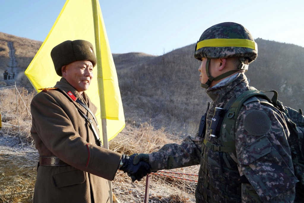 FILE - In this Wednesday, Dec. 12, 2018, file photo provided by South Korea Defense Ministry, South Korean army Col. Yun Myung-shick, right, shakes ha...