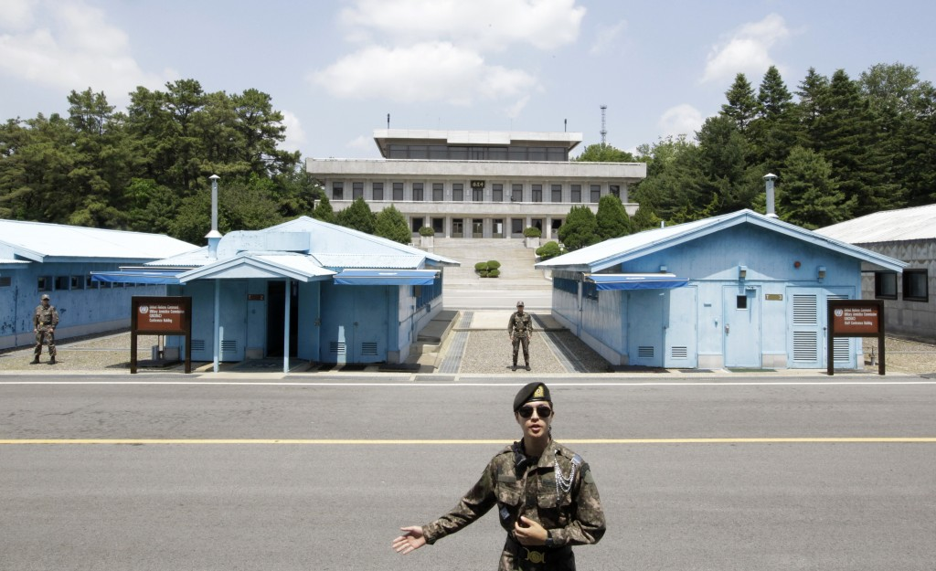 In this June 12, 2019, photo, a South Korean soldier gestures during a press tour at the Panmunjom in the Demilitarized Zone (DMZ), South Korea. U.S. ...