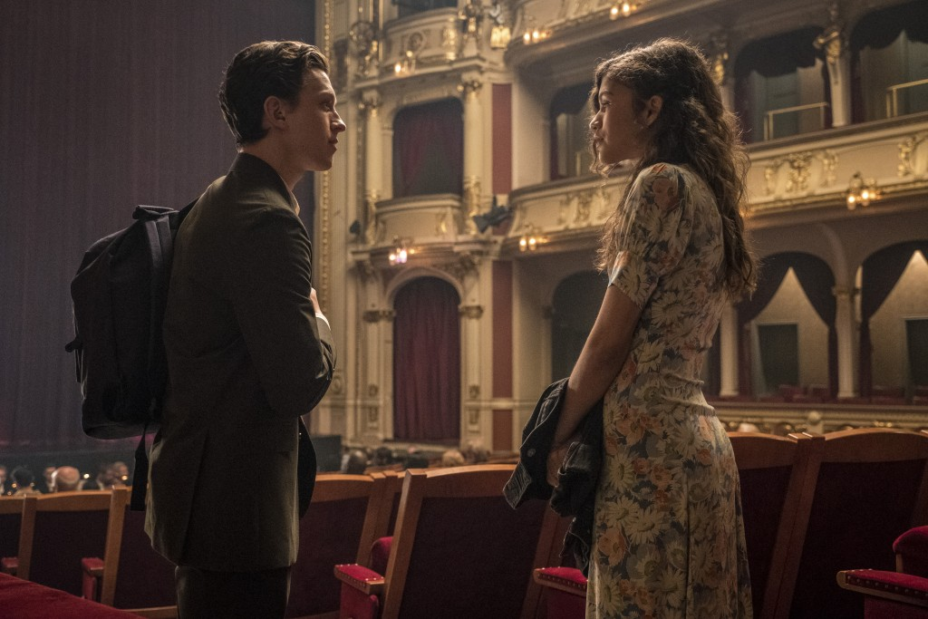 """This image released by Sony Pictures shows Tom Holland, left, and Zendaya in a scene from """"Spider-Man: Far From Home."""" (Jay Maidment/Columbia Pictures..."""