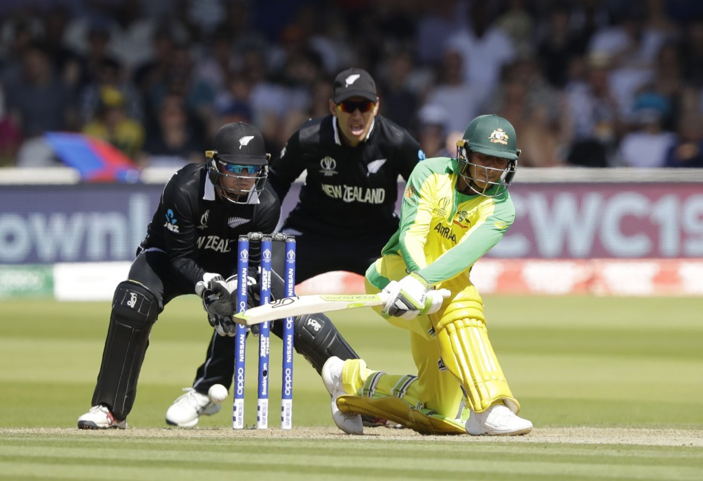Australia's Usman Khawaja plays a shot during the Cricket World Cup match between New Zealand and Australia at Lord's cricket ground in London, Saturd...