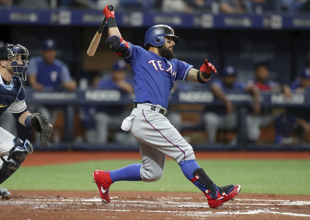 Texas Rangers' Rougned Odor follows through on an RBI double against the Tampa Bay Rays during the second inning of a baseball game Friday, June 28, 2...
