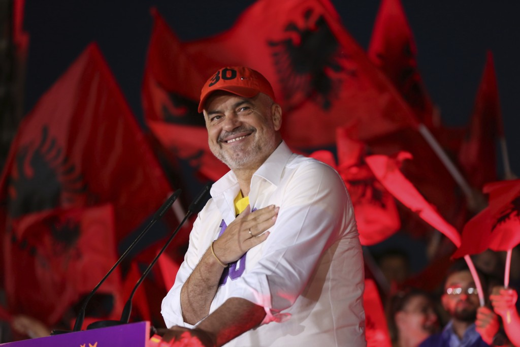 Albanian prime minister Edi Rama thanks his supporters during the last election rally in Vlora, southern Albania, Friday, June 28, 2019. Abania's muni...