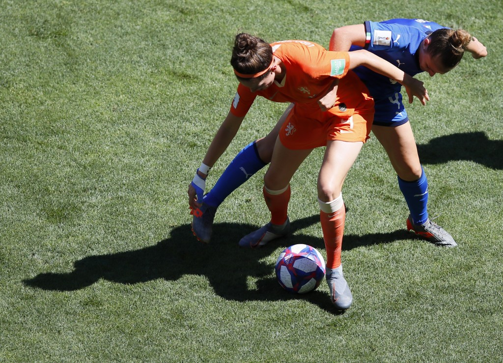 Netherlands' Merel Van Dongen, left, duels for the ball with Italy's Aurora Galli during the Women's World Cup quarterfinal soccer match between Italy...