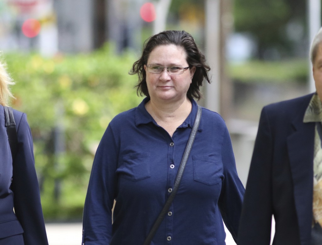 Former Honolulu deputy prosecutor Katherine Kealoha walks into federal court for a hearing to decide if she should be held while awaiting sentencing o...