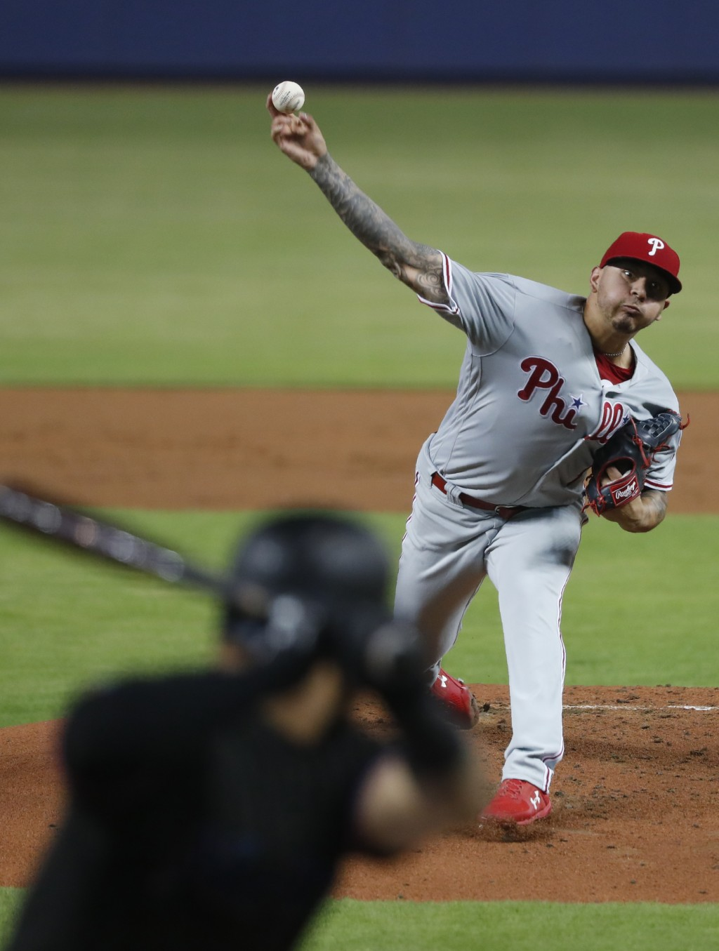 Philadelphia Phillies' Vince Velasquez, top, pitches to Miami Marlins' Harold Ramirez during the first inning of a baseball game, Friday, June 28, 201...