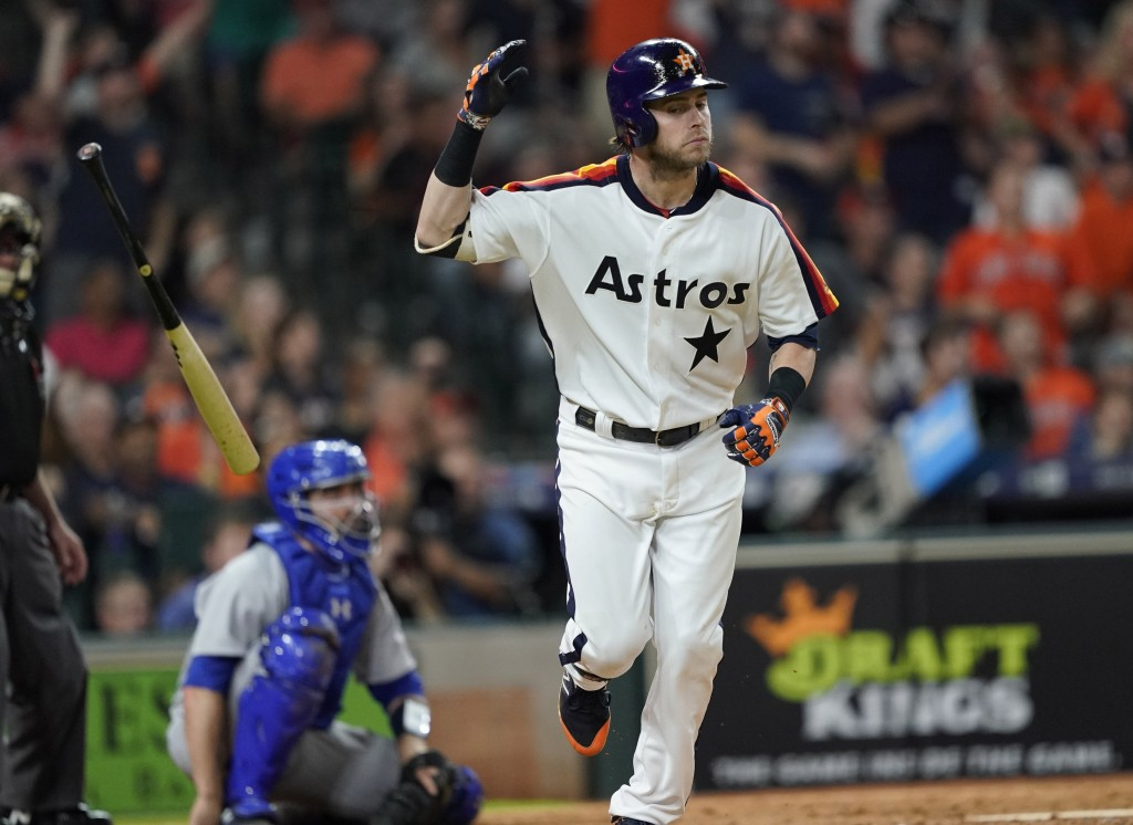 Houston Astros' Josh Reddick tosses his bat after hitting a home run against the Seattle Mariners during the eighth inning of a baseball game Friday, ...